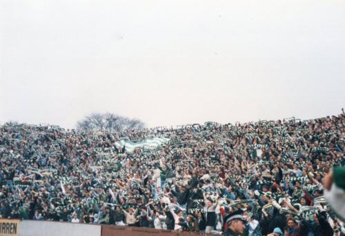 Fans celebrate behind Jim Stewart