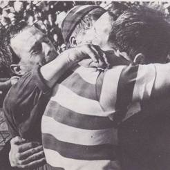 Fans and players celebrate on pitch at Lisbon