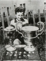Jinky wee boy with big trophies
