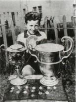 Jinky wee boy with big trophies