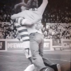 Johnny Doyle and fan celebrate on pitch at Pittodrie 1979