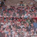 2 guys on chimney above Celtic fans