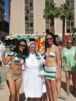A nun and 2 Celtic ladies in swimsuits Las Vegas convention