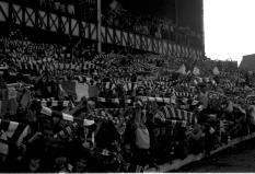 Celtic fans at Ibrox, Enclosure, late 70s or 80s, going mental, walk on
