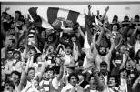 Celtic supporters celebrate 1980s with radio and flag