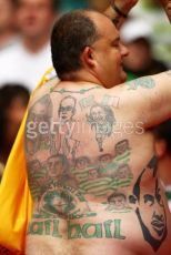 Fan with tatoo on back