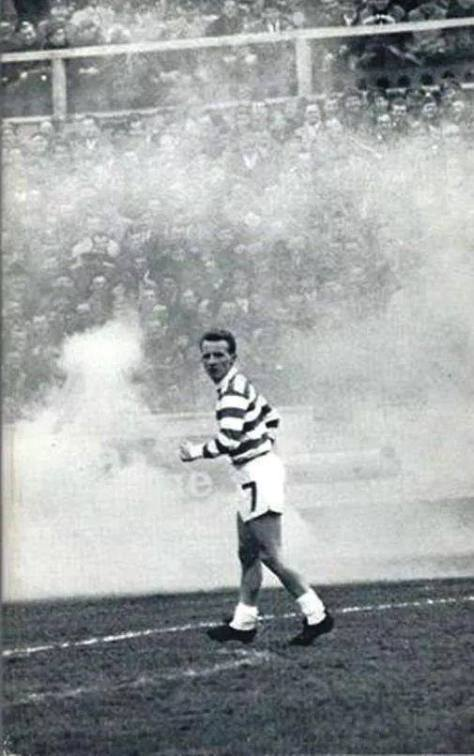 Jinky, smoke flares in the background