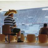 Seville a fan sits alone