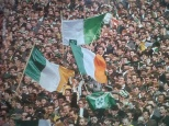 Supporters in 60s with colour tricolours and banners