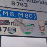 GB skull and SMV balaclava road sign