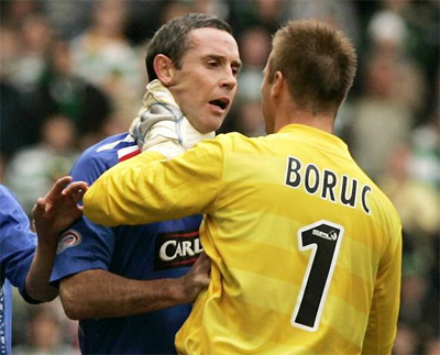 "Celtic's goalkeeper Boruc grabs Rangers' Weir by the throat during their ""Old Firm"" Scottish Premier League soccer match in Glasgow, Scotland"