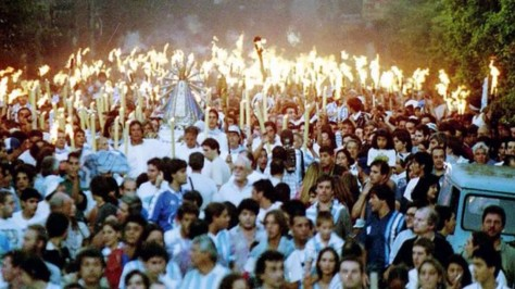 Racing fans and priests holy statue march to exorcism 1998
